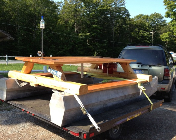 On an Island, this creative picnic table with a beer cooler attached is happiness for those who must fish, drink, and eat