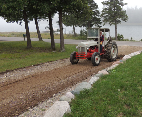 Here I am using that 1948 tractor on Drummond in 2013.
