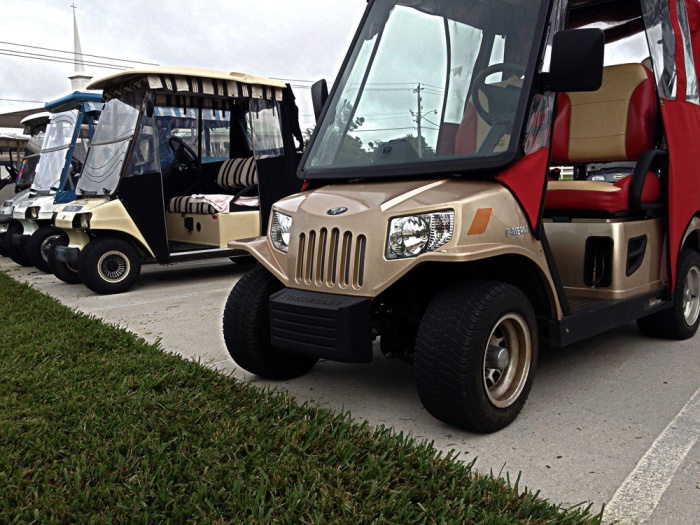 This is a special golf cart created by an artist or a Jeep copycat - but is a piece of art