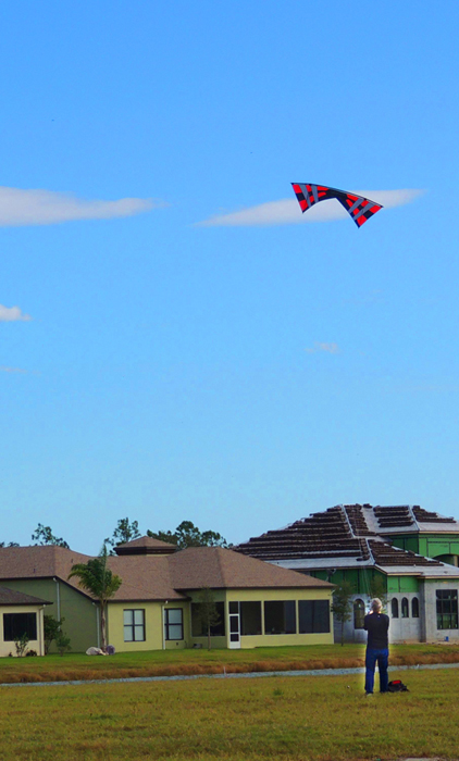 Oh, here is the real untouched by PhotoShop photo of my neighbor flying a kite - it has two strings and he is flying it in great aerial maneuvers. The story - even elderly folks enjoy toys often marketed for young folks!