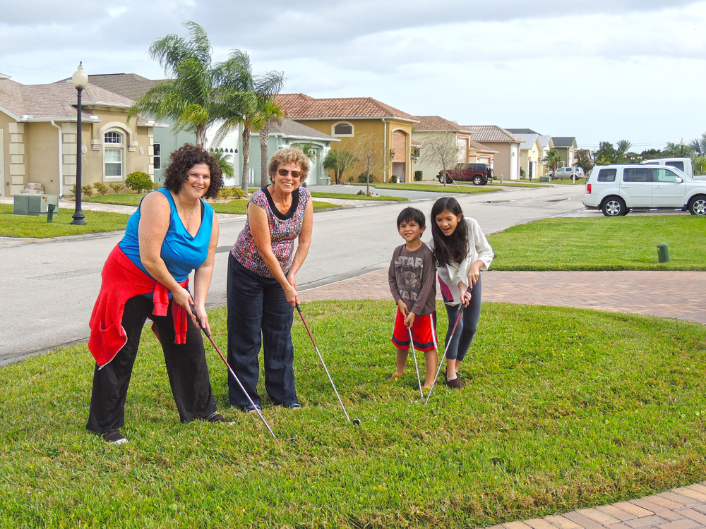 """While getting ready to get in the car and drive to a """"Minature Golf"""" course I caught this practice session in our front lawn."""