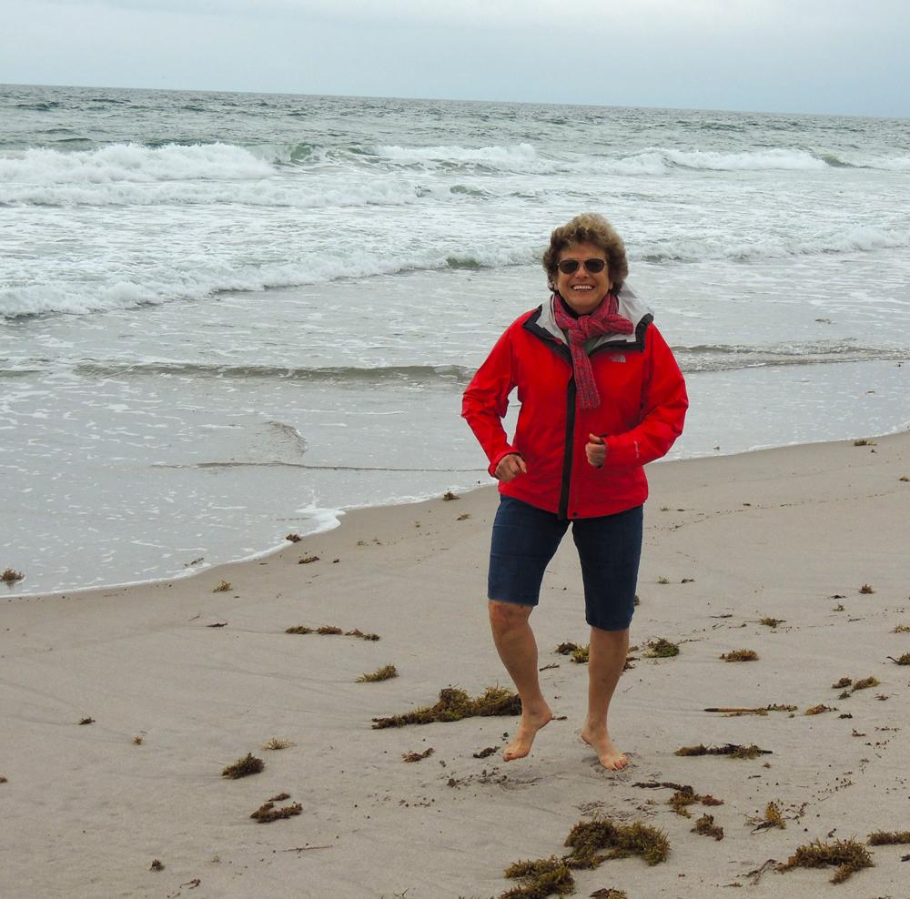 Our annual New Year's day beach walk - Grandma doing a beach dance!