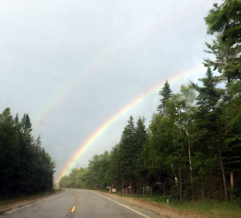 """I think a storm is going to hit my windshield. -- But that is good.  -  """"My heart leaps up when I behold A rainbow in the sky;"""" By Henry W. Longfellow"""