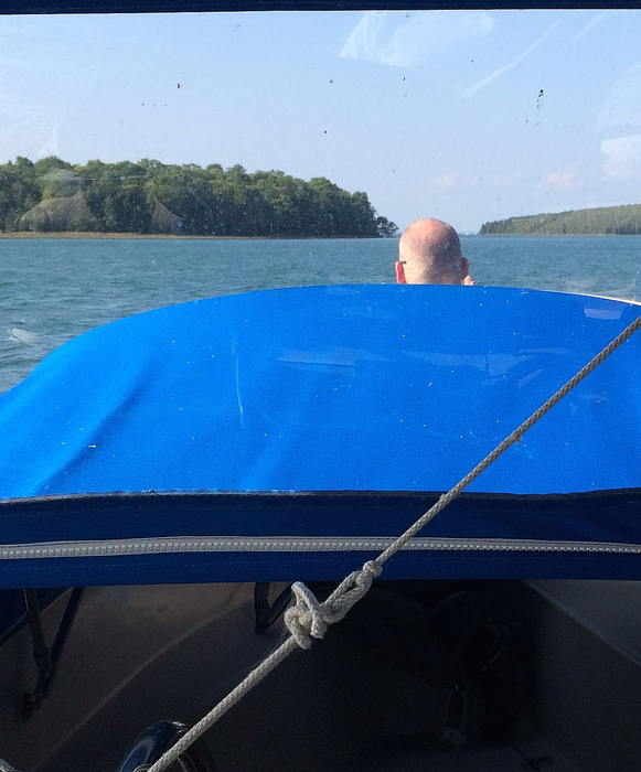 We are drinking in the wild air while riding the waves in the bow of a Boston Whaler