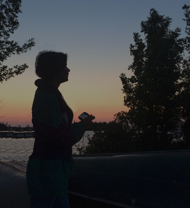 """We are  """"Living in the glow of sunshine as it sets over Potagannissing , with thoughts of swimming the sea, and we are drinking the wild air of a Lake Huron island"""""""